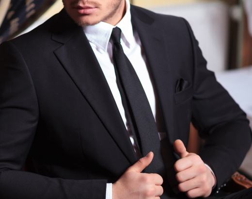 Even if you want to show off who makes your new designer suit, you must remove brand labels from the sleeve! Get            a seam ripper or small pair of scissors and carefully cut the stitches on either side of the label to remove            gently. Don't rip it off, as this could damage the fabric!